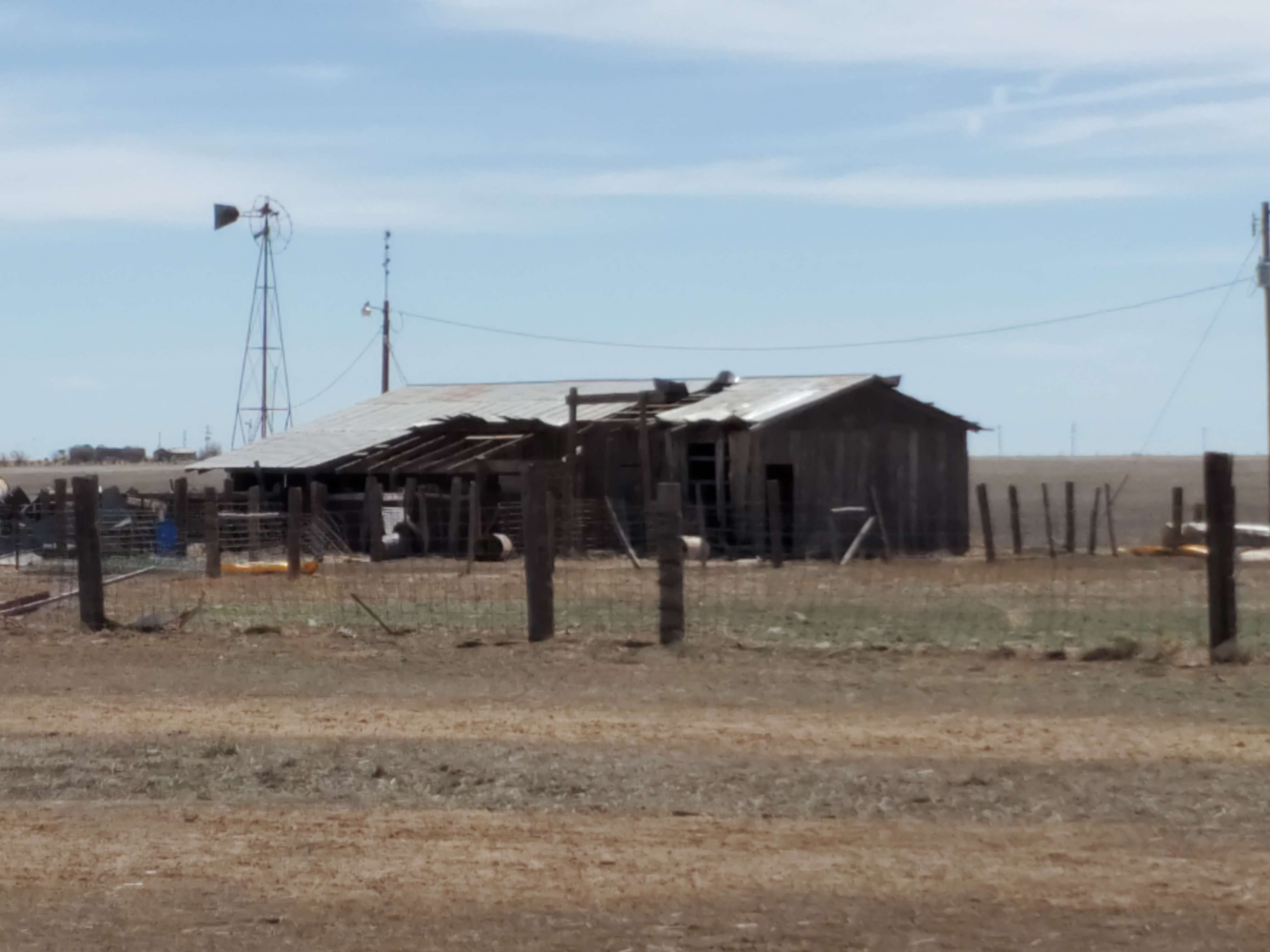 Damaged building located west of Happy, Texas.