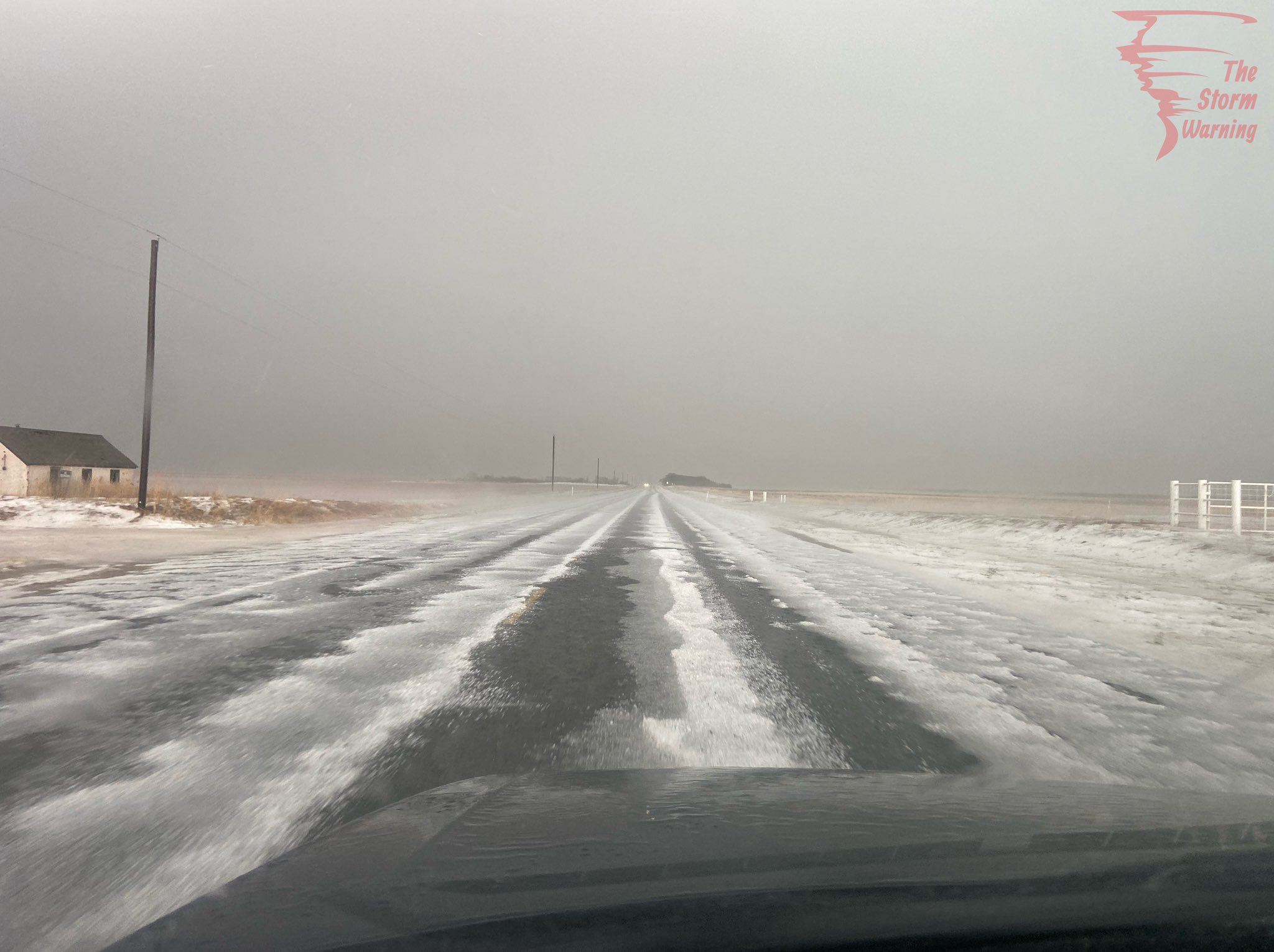 Hail covered roadway just east of Brownfield on Monday afternoon (3 May 2021). The image is courtesy of The Storm warning (@TheStorm Warnin1 on Twitter).