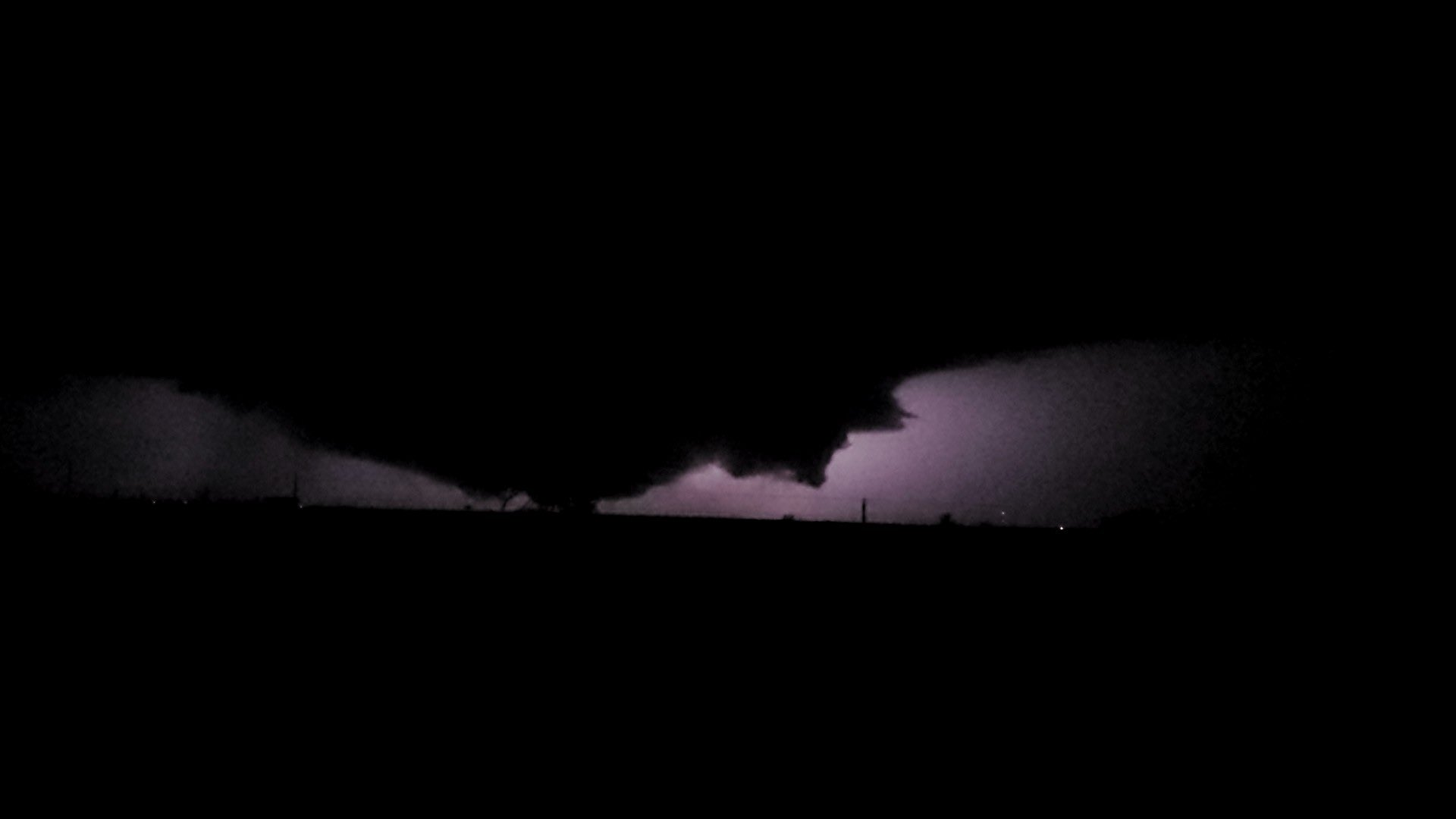 (right) Ground hugging cloud and possible tornado west of Hale Center at 9:35 pm. The image is courtesy of�Adam Young and Matt Ernst.