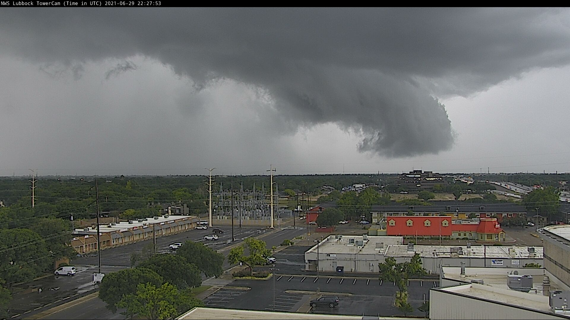 Ominous clouds and torrential rain moving across southwest Lubbock late Tuesday afternoon (29 June 2021).